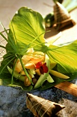 Exotic fruit salad on banana leaf