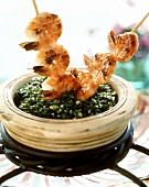Shrimp kebabs on spinach with sesame