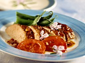Baked lamb fillets with tomatoes and green beans