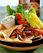 Gyro pita (flatbread filled with meat and onions)