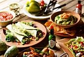Tortillas, chicken wings, nachos with dips