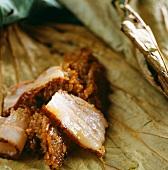 Roast pork with sticky rice on a lotus leaf