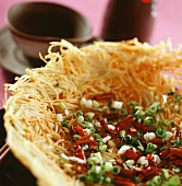 Potato nest with onions and chili peppers (China)