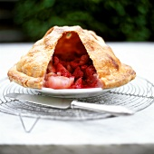 Fruit pie with a piece of crust removed