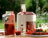 Freshly squeezed berry juice with juicer