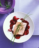 Salmon trout fillet on marinated beetroot