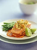 Salmon fillet with herb crust on slice of sweet potato