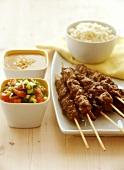 Lamb kebabs with salsa and peanut sauce