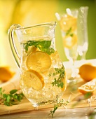 Lemonade with ice cubes and mint leaves in jug