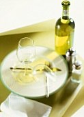 Table setting with wine glasses and white wine