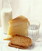 Slices of bread with Parmesan, water and milk