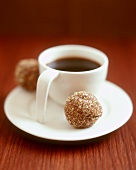 A cup of coffee with chocolate truffle