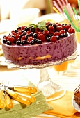Quark cake with berries on cake stand