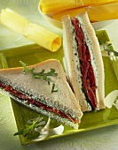 Tramezzino (herb spread and dried tomatoes in a sandwich)