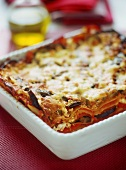 Vegetable lasagne in a white baking dish