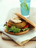 Soya burger with salad and hummus (chick-pea spread)