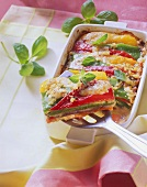 Summer vegetable bake, one piece on server