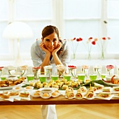Woman in front of party buffet with snacks