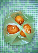 Three pumpkins (Hokkaido) in a plastic bag