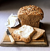 Sunflower seed and pine nut bread; one slice with butter