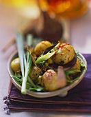Baked potatoes with spices, herbs and spring onions