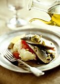 Marinated sardines with olive oil, mashed potato & tomatoes