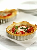 Filo pastry tartlets with pepper and mozzarella filling