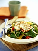 Spinach and tomato salad with grilled Halloumi cheese