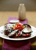 Aubergine and tomato salad with minted yoghurt dressing