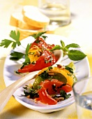 Pepper antipasti with parsley and mint sauce