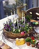 Easter wreath with candles, various Easter decorations on table