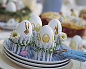 Easter eggs in decorative egg-cups (made from miniature fences)