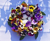 Easter wreath of pansies, three white eggs in the centre