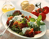 Mixed salad leaves with tomatoes & soft cheese with herbs