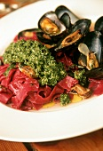 Beetroot tagliatelle with pesto and mussels