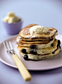 Blueberry and ricotta pancakes with sweet maple syrup butter