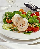 Salmon & pike-perch roll on spinach salad with cherry tomatoes