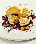 Mushroom pirogi on onions in red wine with lavender flowers