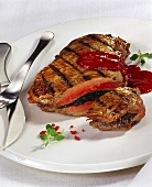 Stuffed, grilled steak with fiery ketchup