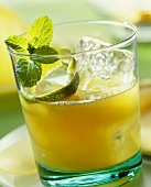 Mai Tai in glass, garnished with lime peel and mint