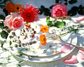 Edible flowers on a place setting with fork