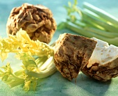 Celeriac and sticks of celery, one celeriac bulb cut open