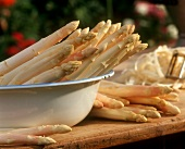 White asparagus spears in a dish on wooden table