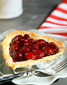 Heart-shaped cherry tartlet