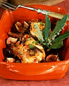 Braised rabbit leg with figs in roasting dish