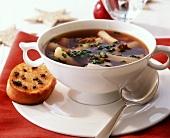Cep bouillon with scorzonera; truffle baguette