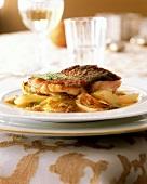 Oven-baked carp fillet on fennel and oranges