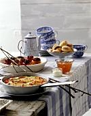 Winter brunch with vegetable tortilla, baked apples, milk rolls
