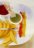 Mango slices with fruit sauces