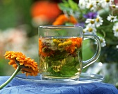 Glass of herb tea made from herbs and flowers